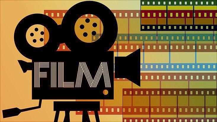 Kamera in Cartoon Optik mit Filmrollen